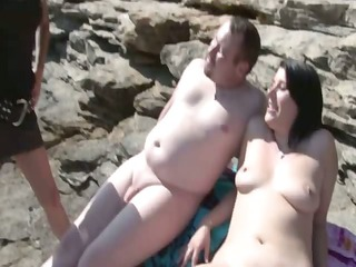 brunette screwed on the beach by strangers