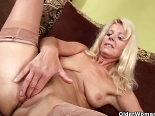golden-haired granny in stockings strips off and