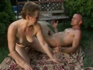 lusty bushy granny enjoying sex with a boy