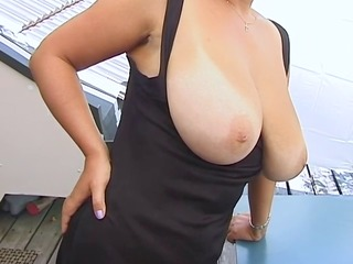 golden-haired huge-boobs-milf posing