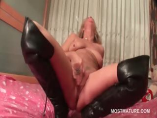 aged in leather boots doing herself in daybed