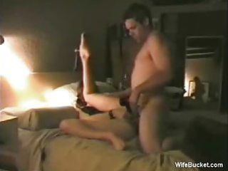 wife rotates a large dildo and a glad pecker