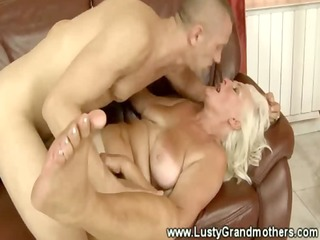 Blonde granny loves to get dirty in living room