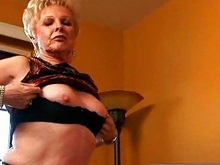 naughty blond granny showing moist love tunnel
