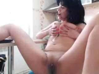aged brunette chats on the web and fingers her