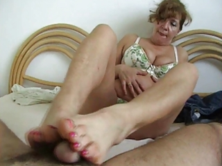 Mature whore make a footjob