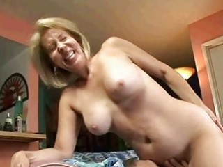 golden-haired granny sucks on rod then receives
