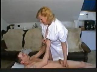 chubby blond granny nurse gives her patient head