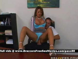 mature breasty redhead doxy at work on a chair
