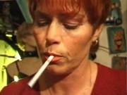 kira red older german plumper smokes a cigarette
