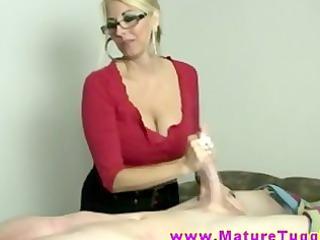 golden-haired milf massages schlong with her hands