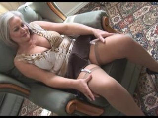 attractive breasty granny in stockings stripping