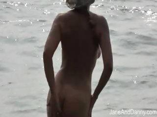 voyeur bonks hot milf on the beach