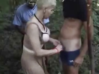 lewd wife has fun wuth voyeurs in forest.