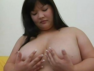 big asian momma with big scoops plays with her