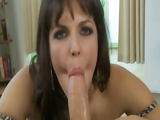 sexy breasty brunette hair is sucking his knob