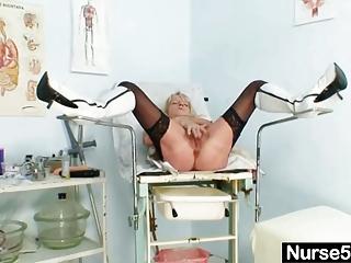 grandma in uniform spreads blond bushy cunt