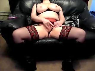 concupiscent wife on a leather daybed at home