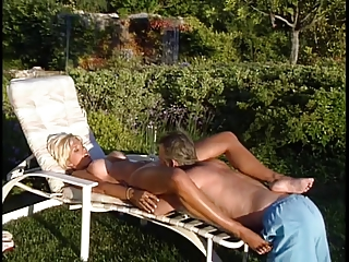 older blonde lifeguard receives her big bra