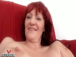 german aged redhead plays with her hirsute snatch